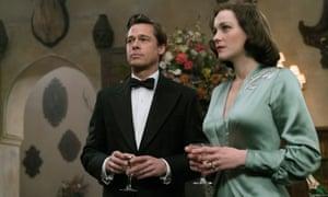 Brad Pitt with co-star Marion Cotillard in Allied.