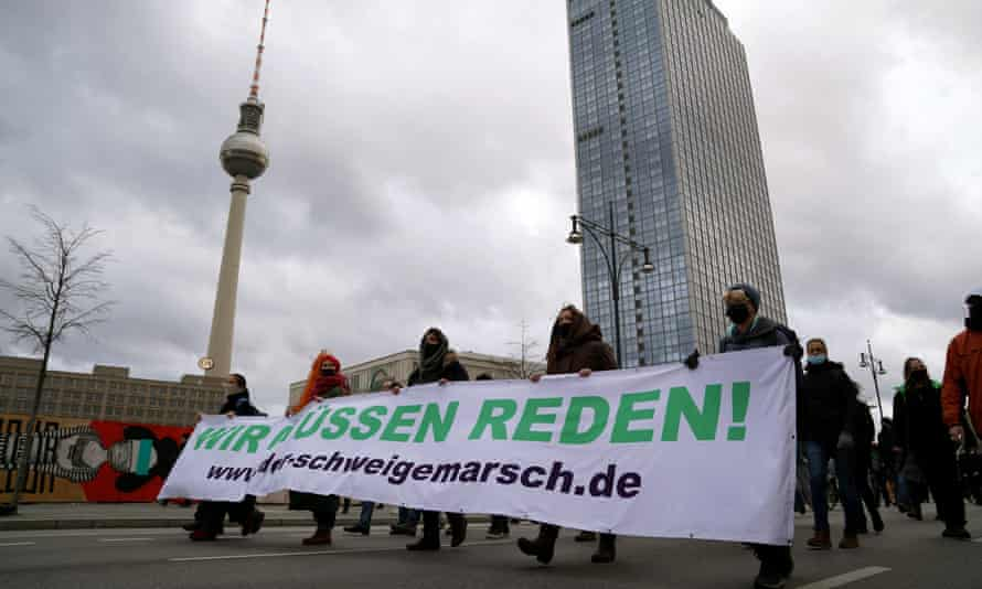Protesters march in silence during a demonstration against German coronavirus restrictions in Berlin.