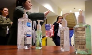 Hand sanitizer is offered to attendees of a Joe Biden rally on Monday in Detroit, Michigan.