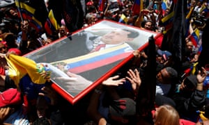 Nicolas Maduro supporters demonstrate outside the Legislative Palace during the assembly's first session, in Caracas.