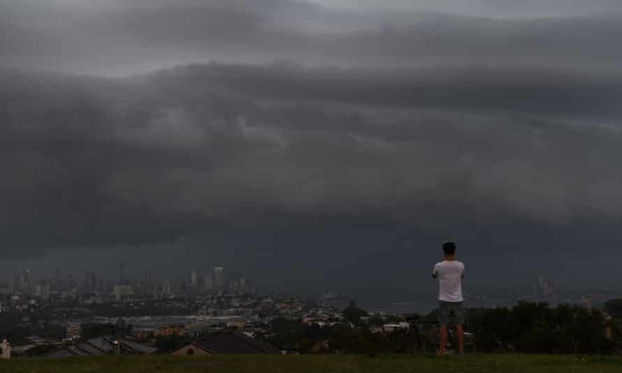 An onlooker at Dudley Page Reserve watches as a large thunderstorm moves over Sydney