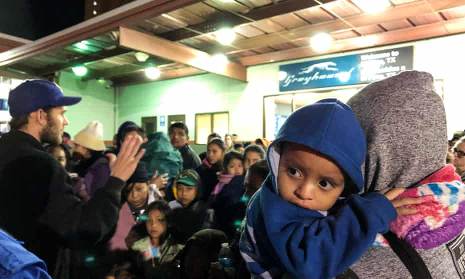 Migrants who were dropped off at a bus station by US Immigration and Customs Enforcement (Ice), wait for transportation to emergency shelters in El Paso, Texas.