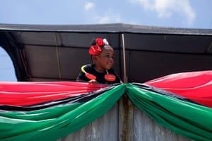 A girl looks out from a parade float during a Juneteenth parade in Galveston, Texas, on June 19, 2021