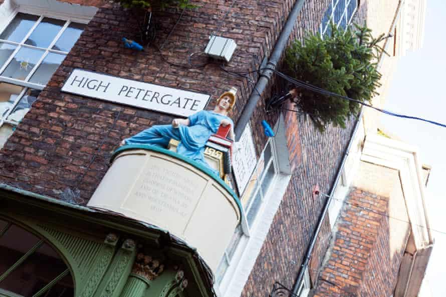High Petergate York City road street sign Centre UK England statue figure of Minerva goddess of wisdom and drama