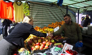 Green Party leader Natalie Bennett walks through Ridley Road Market while canvassing in the Borough of Hackney.