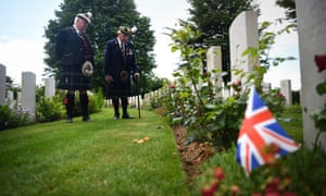 A veteran looks at graves at the Commonwealth War Graves Commission cemetery in Bayeaux, France
