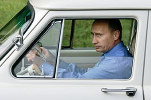 """August 2005: Putin takes a ride in his 1956 """"Volga"""" as he attends the opening ceremony of a new 3km-long tunnel in the Krasnodar region"""