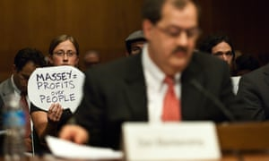 A protester holds a sign behind Don L Blankenship during a Senate hearing on mine safety 20 May 2010 in Washington, DC.