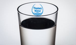 A glass of water with a Thames Water logo