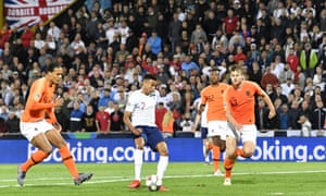 England's Jesse Lingard, second left, slots the ball home.