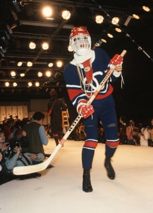 A model walks the runway in hockey-inspired apparel during the Chanel Ready to Wear show, Autumn/Winter 84/85