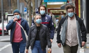 People wear masks in Bourke Street in Melbourne, where people face a $200 fine for not wearing a face covering in public as Victoria tries to curb a second wave of coronavirus.