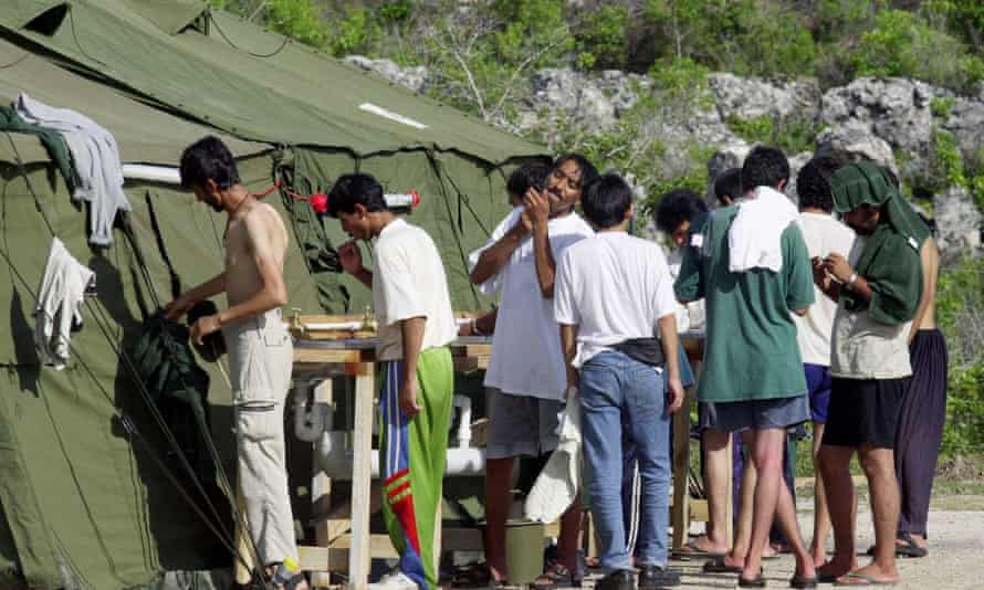Men shave, brush their teeth and prepare for the day at a refugee camp on the island of Nauru
