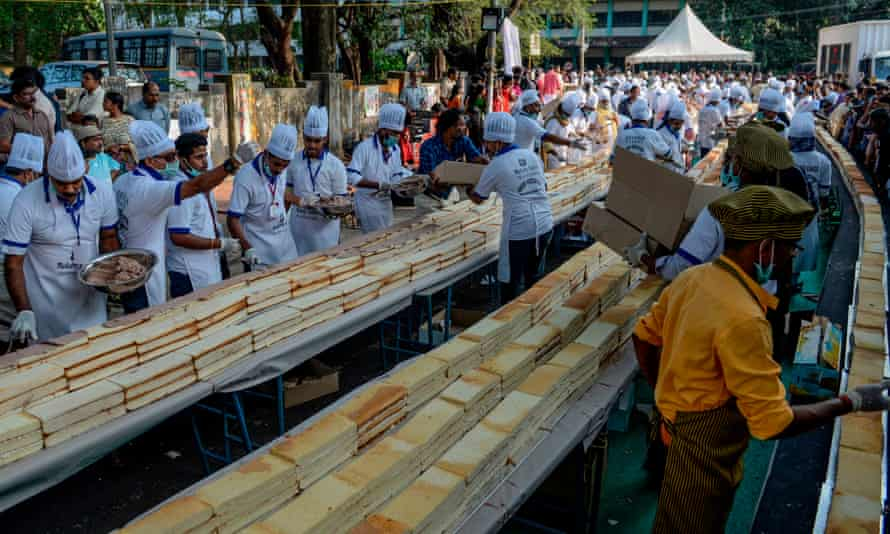 About 1,500 bakers and chefs in Thrissur in the south Indian state of Kerala prepare a 6.5km cake in an attempt aim to break the Guinness World Record.