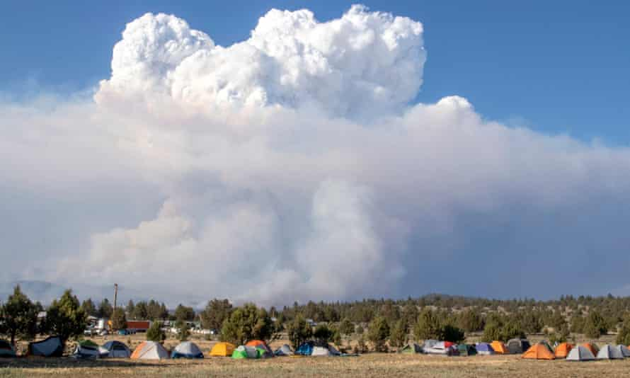 A pyrocumulus cloud drifts into the air north of the Bootleg fire forward operating base in Bly, Oregon.