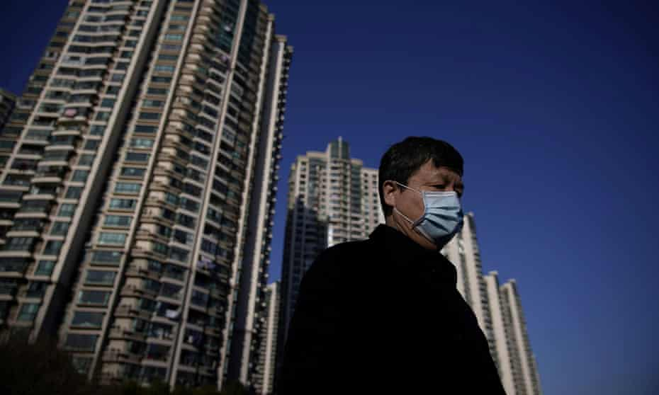 A man wearing a mask is seen in Shanghai, China, on 20 February.