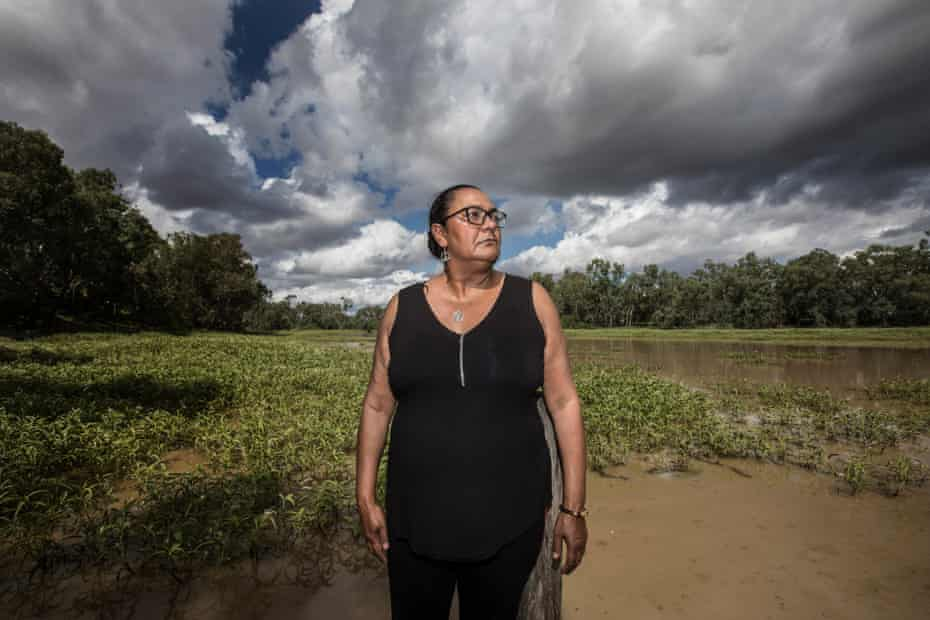 Judy Duncan stand by the muddy Mehi river that runs through Moree