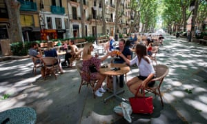 People have an aperitif together at a terrace bar in Palma de Mallorca