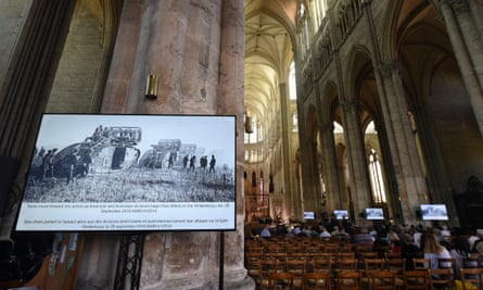 Photographs of the Battle of Amiens are displayed as guests arrive at Notre-Dame cathedral in Amiens