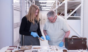 Deborah Tout-Smith and Judith Fraser inspect Mick Ward's items, including the leather suitcase.