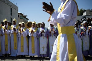 Worshippers sing and clap during a procession