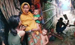Rohingya refugees outside their makeshift tent in the Kutupalong camp in Cox's Bazar