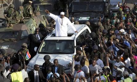 Gambian president Adama Barrow greets the crowds at Banjul airport.