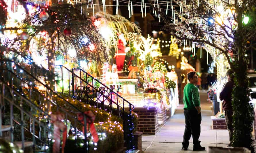 People look at a house decorated in Dyker Heights on 8 December.