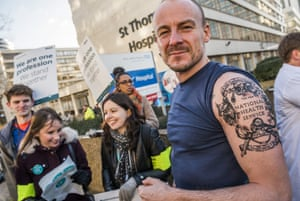 A doctor in London shows off his NHS tattoo