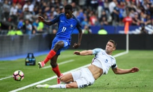 Ousmane Dembele of France is tackle by Gary Cahill of England