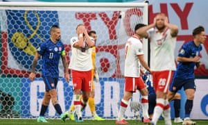 10 men Poland dejected at full time.