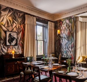 Striking views: the dining room with Guillermo Kuitca muralled walls and a Gerhard Richter eagle.