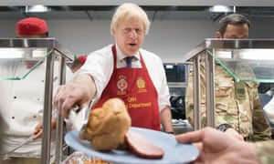 Boris Johnson served turkey and Yorkshire puddings to British troops stationed in Estonia.