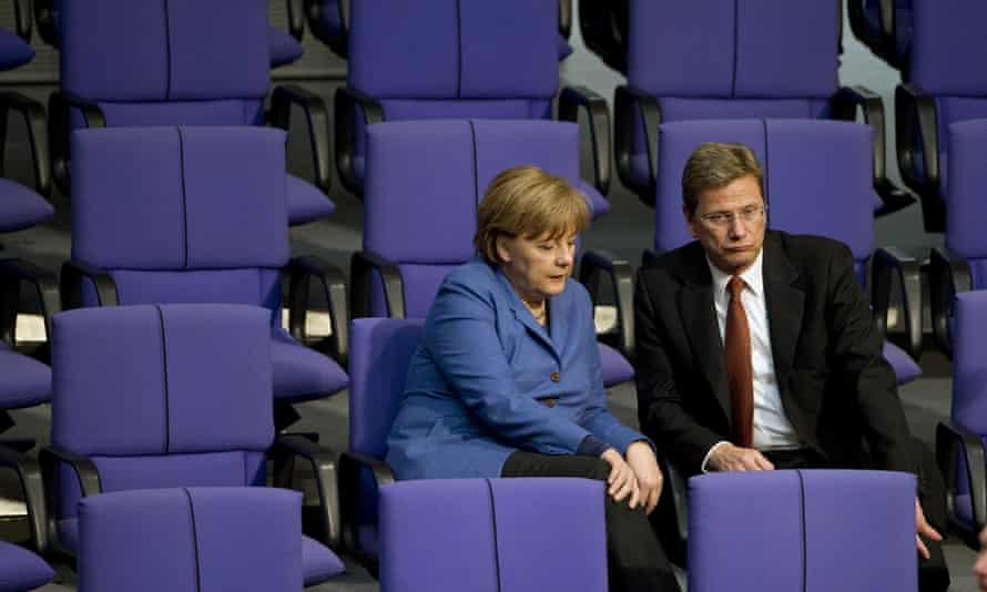 Westerwelle with Angela Merkel at the Bundestag, the lower house of parliament, in Berlin.