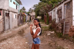 Pura stands on her street a few days after her quinceañera.