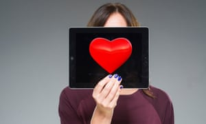 Woman holding iPad with heart on
