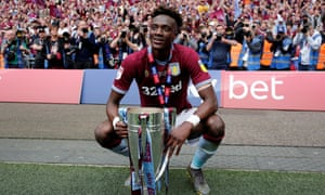 Tammy Abraham celebrates winning promotion with Aston Villa.