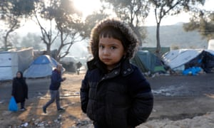 Greece/Lesbos/ Jan 12,2020. A child poses for a photo at the makeshift camp set next to Moria, on the island of Lesbos, Greece. Giorgos Moutafis for The Guardian