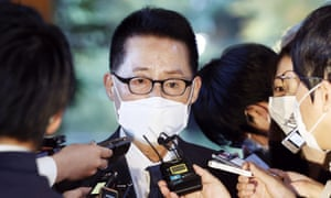 South Korea's National Intelligence Service Director Park Jie-won is surrounded by journalists after meeting with Japanese Prime Minister Yoshihide Suga at the prime minister's office in Tokyo Tuesday, 10 November, 2020.