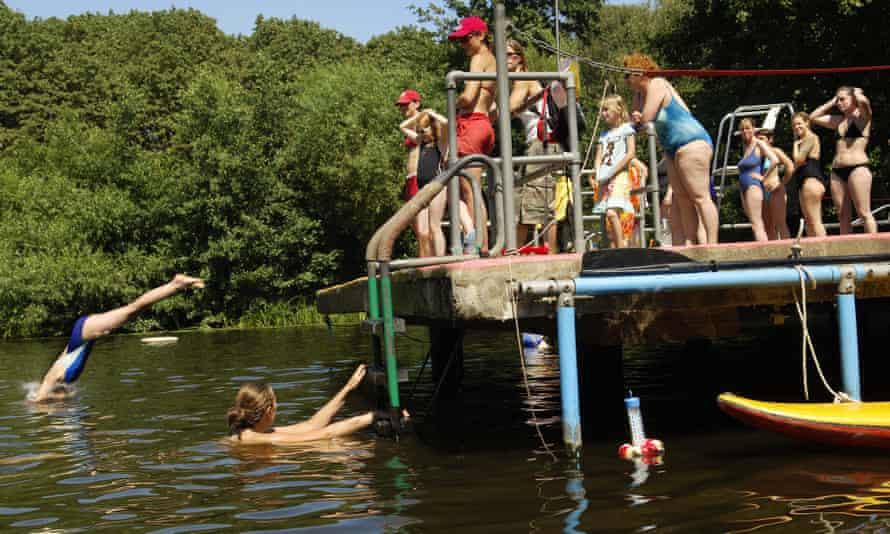 Women swimming in pond