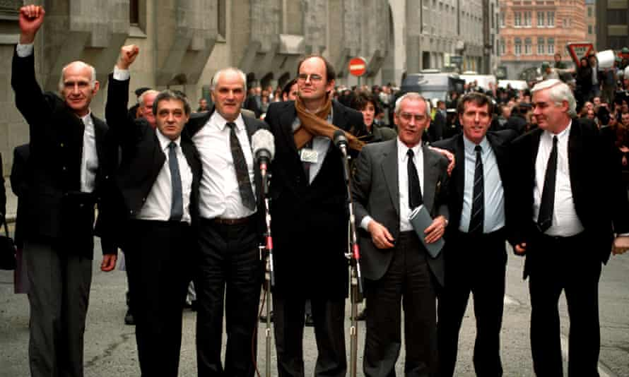 The Birmingham Six (left to right) John Walker, Paddy Hill. Hugh Callaghan, Chris Mullen MP, Richard McIlkenny, Gerry Hunter and William Power, outside the Old Bailey in London on  14/03/91, after their convictions were quashed