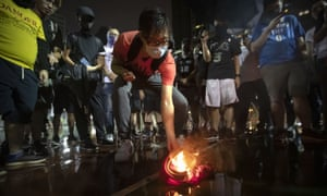 Demonstrators set light to a LeBron James jersey  during a rally