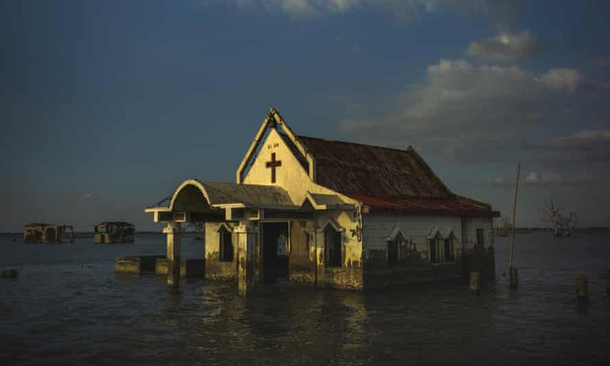 Sea water engulfs the church of Pariahan village, north of Manila, Philippines, in November 2018.