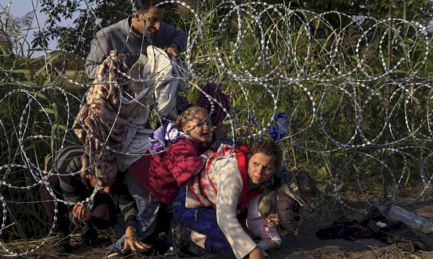 Syrian migrants enter Hungary at the border with Serbia in 2015.