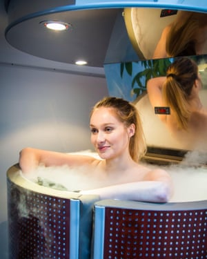 A woman in a cryotherapy chamber