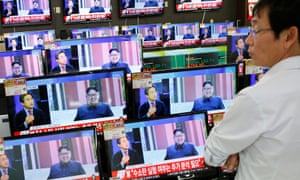 A sales assistant in Seoul watches TV sets broadcasting a news report on North Korea's fifth nuclear test on Friday.