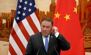 US Secretary of State Mike Pompeo adjusts his earpiece during a press conference in China
