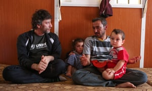 Gaiman meets Ayman and his family at Za'atari refugee camp.