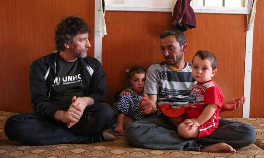 Gaiman meets Ayman and his family at Za'atari refugee camp.