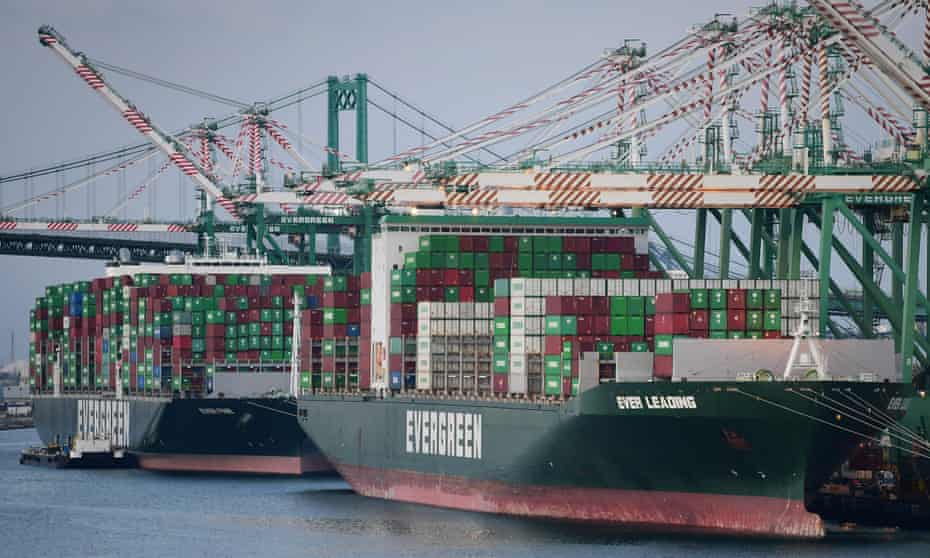 Cargo ships filled with containers dock at the Port of Los Angeles